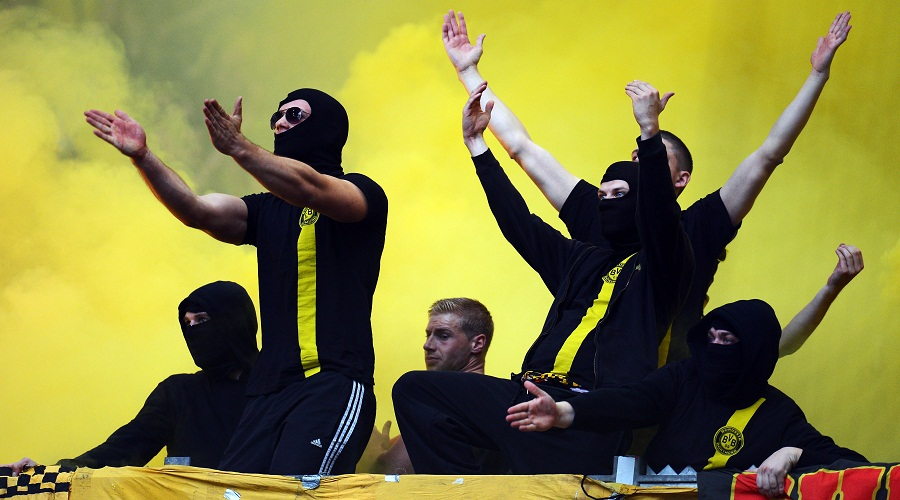 GELSENKIRCHEN, GERMANY - OCTOBER 26: Fans of Dortmund trow flares and firework prior to the Bundesliga match between FC Schalke 04 and Borussia Dortmund at Veltins-Arena on October 26, 2013 in Gelsenkirchen, Germany.  (Photo by Lars Baron/Bongarts/Getty Images)