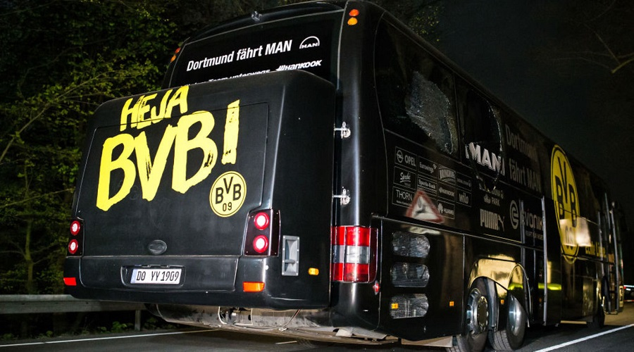 DORTMUND, GERMANY - APRIL 12: Team bus of the Borussia Dortmund football club damaged in an explosion is seen on April 12, 2017 in Dortmund, Germany. According to police an explosion detonated as the bus was leaving the hotel where the team was staying to bring them to their Champions League game against Monaco. So far one person, team member Marc Bartra, is reported injured.   (Photo by Maja Hitij/Getty Images)